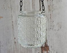 Glass candle holder repurposed from vintage glass light cover
