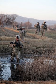Marines cross a canal in Afghanistan by United States Marine Corps Official Page, via Flickr