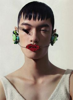 Lv Piqiang wearing a mouthpiece from Walter Van Beirendonck F/W 2013, photographed by Fan Xin for GQ Style China