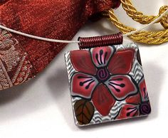 GREAT BAIL!!!!!!!                           Simple Elegance Polymer Clay Pendant with Burgundy Flowers on Silver Striped Background
