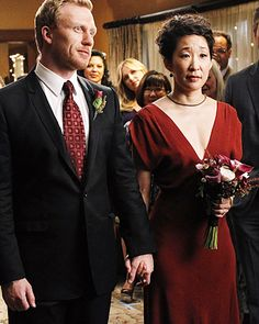 "Grey's Anatomy's Cristina Yang and Owen Hunt Doctors Cristina Yang (Sandra Oh) and Owen Hunt (Kevin McKidd) said ""I do"" on Grey's Anatomy's season seven premiere in 2010. The bride wore a simple burgundy dress with a plunging neckline."