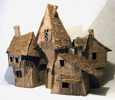 Cardboard Houses....reminds me of Harry Potter. these would be cool for a…