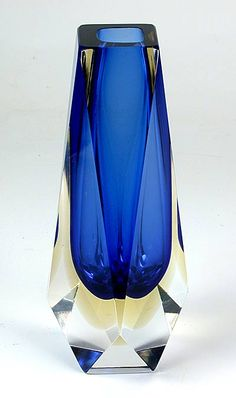 A Murano vintage triple case vase made by Mandruzzato in the The faceted glass is triple cased in jewel tone blue, pale yellow and clear. Glass Paperweights, Glass Vase, Cut Glass, Clear Glass, Glas Art, Colored Vases, Cobalt Glass, Blown Glass Art, Antique Perfume Bottles
