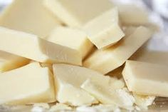 What is in white chocolate? Is white chocolate truly chocolate? Technically, white chocolate is a cocoa plant product. But, it lacks any of the chocolate solids that define milk and dark chocolate. Read up and decide. Happy Chocolate Day, Vegan White Chocolate, White Chocolate Recipes, Types Of Chocolate, Chocolate Brands, Chocolate Chocolate, Chocolate Company, Belgian Chocolate, Chocolate Factory