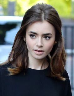 Lily Collins' voluminous half-up hairstyle
