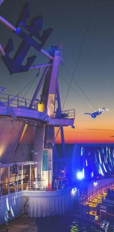 Harmony of the Seas | Come Seek the exhilarating, aerialist-driven shows at the Aquatheater, one of many nighttime attractions aboard the world's largest ship.