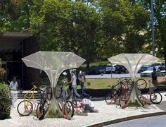 Umbrella-arc bike rack. You could make the tops solar and have energy producers