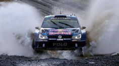 Ogier and Ingrassia drive through a water splash in their Volkswagen Polo R Sport Cars, Race Cars, Vw Motorsport, Rallye Wrc, Polo R, Rally Raid, Volkswagen Polo, Racing Motorcycles, Running