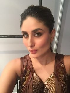 Kareena takes a selfie before heading out on stage at Magnum's #NewFaceOfPleasure launch .
