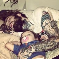 Cute tattooed daddy & son