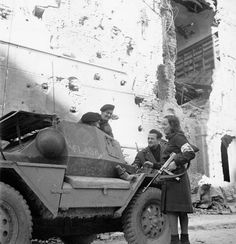 Troopers W. Gallant of a Canadian reconnaissance regiment speaking to partisans Louisa and Italo Cristofori after the capture of Bagnacavallo, Italy, 3 January 1945 - Library and Archives Canada - pin by Paolo Marzioli Canadian Soldiers, Canadian Army, Canadian History, European History, Italian Campaign, North African Campaign, Armored Vehicles, Armored Car, Military Photos