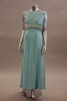 A Norman Hartnell `Le Petit Salon' turquoise slubbed silk evening gown, mid 1960s