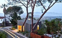 Starting with a vacant lot that was half of the typical minimum lot size, the objective was to compensate for the relatively small footprint of the house.  T...