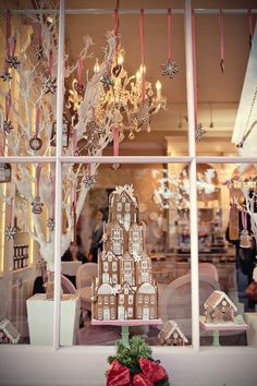 Holiday Home Decor and Decoration Ideas. Gingerbread house and ornaments with pink ribbon.