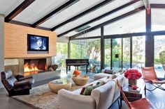 John Legend and Chrissy Teigen's Los Angeles Home features a contemporary open hearth #fireplace