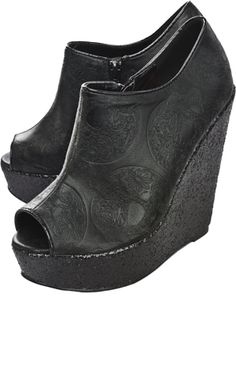 """IRON FIST MANSLAYER WEDGES    The Manslayer wedge booties from Iron Fist have all over embossed sugar skull print and black glitter platforms. Zip closure on the side, leopard liner and open toe.  4 1/2"""" heel    $60.00"""