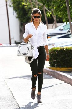 Alessandra Ambrosio, 35, dresses up a distressed pair of black skinny jeans with a crisp white button-down shirt