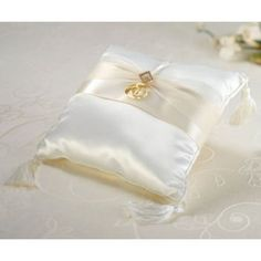 This ring pillow is covered in creamy ivory satin. An ivory satin and sheer ribbon decorates the front, complete with gold rhinestone diamond orna Ring Bearer Pillows, Ring Pillows, Diamond Wedding Rings, Diamond Rings, Gold Rings, Lillian Rose, Garter Set, Satin Flowers, Ivoire