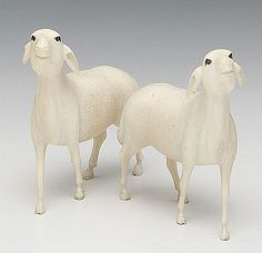 A Pair of Finely Carved Ivory Sheep, 19th c., with black painted eyes