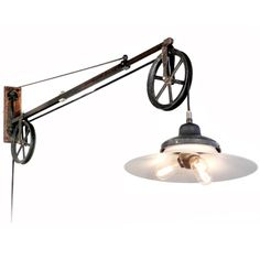 Original Swing Arm Dental Pulley With Large Milk Glass Lamp   From a unique collection of antique and modern wall lights and sconces at https://www.1stdibs.com/furniture/lighting/sconces-wall-lights/