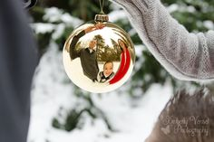 Christmas Family Photo - Reflection family photo with Christmas ornament.  Not an original idea of mine, but we had fun with this during a recent snowy photo session.    www.kimberlyvensel.com   Christmas, Family, Photography, Ornaments, Snow, Winter, Family photos
