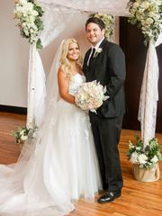 The chuppah was designed by Enchanted Florist.