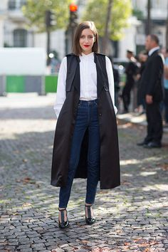 Street Style: Paris Fashion Week Spring 2014 long black vest overcoat high waisted dark skinny jeans white top red lips