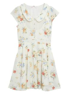 Lovely spring dress-- I would add a distressed leather belt and combat boots.