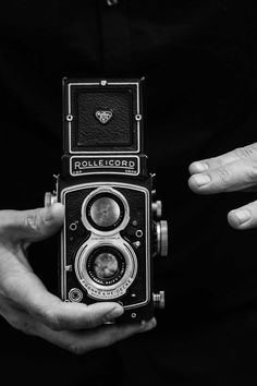 Free download of this photo: https://www.pexels.com/photo/grayscale-photography-of-man-holding-rolleicord-camera-594380/ #black-and-white #man #person