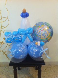 Rubber ducky balloon centerpieces great for baby showers for Baby bottle balloon decoration