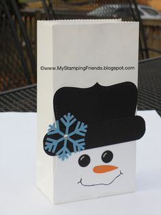 A snowman gift bag made with the Stampin' Up! Top Note die and punches