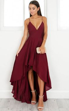 This dress is simple but gorgeous! It features a plunging neckline and thigh split to make it a fun, flirty dress for your next occasion!