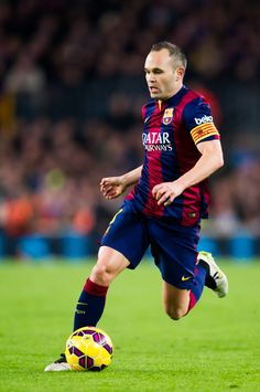 Andres Iniesta of FC Barcelona runs with the ball during the La Liga match between FC Barcelona and Club Atletico de Madrid at Camp Nou on January 11, 2015 in Barcelona, Catalonia.