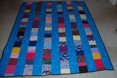 Memory quilt made for a young lady who I've known from the day she was born.  Pieces of fabric from clothes I made for her when she was little.