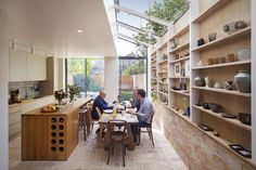 A wall of storage filled with art and ceramics features inside this house that architect Neil Dusheiko has renovated for his father-in-law, near his own home in north London. Victorian Terrace, Victorian Homes, Edwardian House, House Extension Design, House Design, Kitchen Island Dimensions, Casa Cook, Kitchen Island With Seating, London House