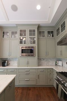 Hollingsworth Interiors - kitchens - gray green cabinets, green gray cabinets, gray green kitchen cabinets, green gray kitchen cabinets, ins. Tall Kitchen Cabinets, Green Cabinets, Kitchen Redo, New Kitchen, Vintage Kitchen, Kitchen Ideas, 1960s Kitchen, Island Kitchen, Kitchen Cabinets With Handles