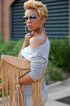 Love the cute, color, her sunglasses, her purse and her sweater.  Lol.. Beautiful