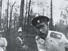 Maria Feodorovna in the background with son Nicholas.