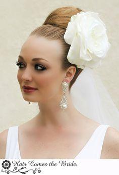 Top Knot Bridal Hairstyle with Dramatic Bridal Hair Flower by Hair Comes the Bride ~ #bride #bridal #wedding#bridalhair #bridalmakeup  #weddinghair #bridalhairstyles #topknotbun