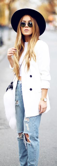 Angelica Blick is wearing a white blazer and bag from Zara, white top from River Island and jeans and hat are both from Monki