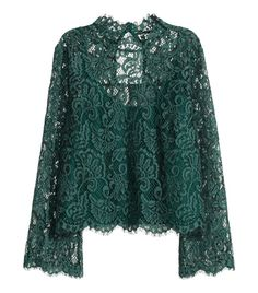 Best 12 Lace blouse: Gently flared blouse in lace with a low stand-up collar, an opening with a concealed button at the back of the neck and long trumpet sleeves. A jersey cami is sewn into the inside of the blouse. Kebaya Lace, Kebaya Dress, African Fashion Dresses, Hijab Fashion, Fashion Outfits, Lace Camisole, Lace Dress, Blouse Styles, Blouse Designs