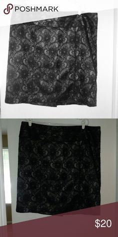 Skirt Pretty and flattering black lace overlay skirt.  The background color is grey. Relativity Skirts Midi
