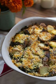 Here is a simple, nourishing side dish for fall: a light gratin with shredded kale and potatoes. Our local farm has potatoes galore right now, and the kale is starting to sweeten up as the nights cool. This dish will take you into late fall and early winter and still be considered seasonal and local for those of us living in much of the northern hemisphere.