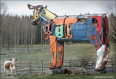 Giant cows made of car parts