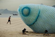 Big Fish by Rio + 20 via mymodernmet: Created out of discarded plastic bottles and illuminated at night with blue and red LED lights, this fish was an environmental statement  at the UN Conference on Sustainable Development in Rio. #Installation #Fish #Green