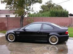 Black e46 m3 with gold bbs