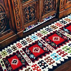 """Кувери"" на пољу, ""ченђели"" на плочи. Pirot Kilim at the royal doors. Pirot kilim is a unique and highly regarded brand of flat tapestry-woven carpets or rugs, made of pure sheep's wool ( from Stara Planina, southeastern Serbia), dyed with natural colours and long enduring. Has 28 weave lines in 1cm and both sides of the rug can be used. Its patterns and ornaments are unique: 96 of them are geographically protected and exclusive for Pirot, Serbia. Photo: Tanjica Perovic"