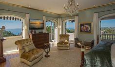 An elegant bedroom overlooking the Pacific Ocean.