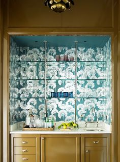 Wet bar with lacquered moss green finish and   Japanese floral wallpaper