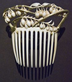 """c. 1900 by Rene Lalique, vine & berries hair comb, gold & ivory.  Included in Museum of Fine Arts, Boston, 2008 exhibition """"Imperishable Beauty"""""""